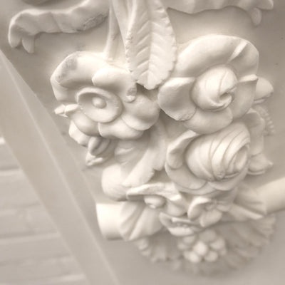 floral carved fireplace