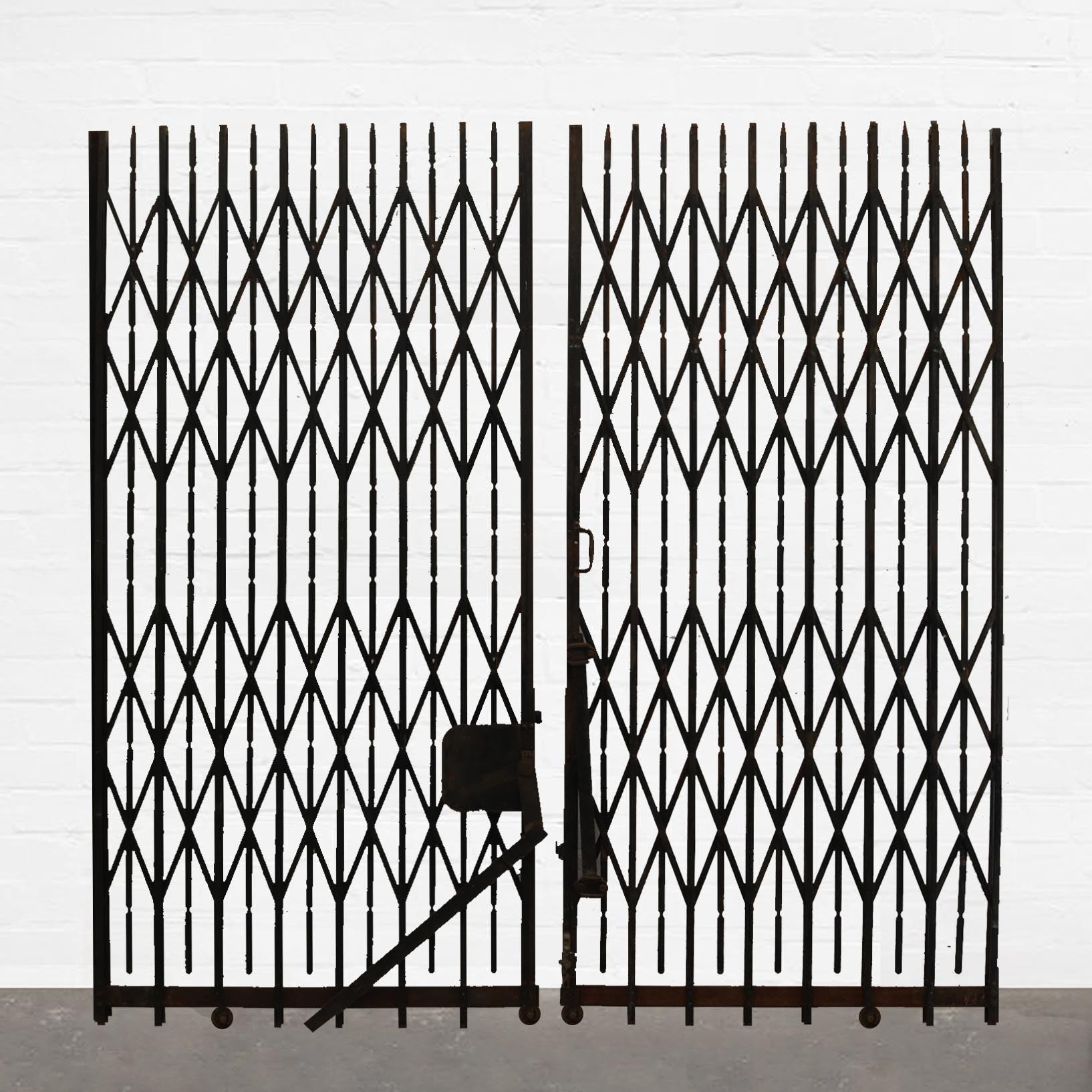 Double Concertina Gates / Lift Doors - The Architectural Forum