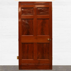 An original Georgian six panel door in flamed cuban mahogany