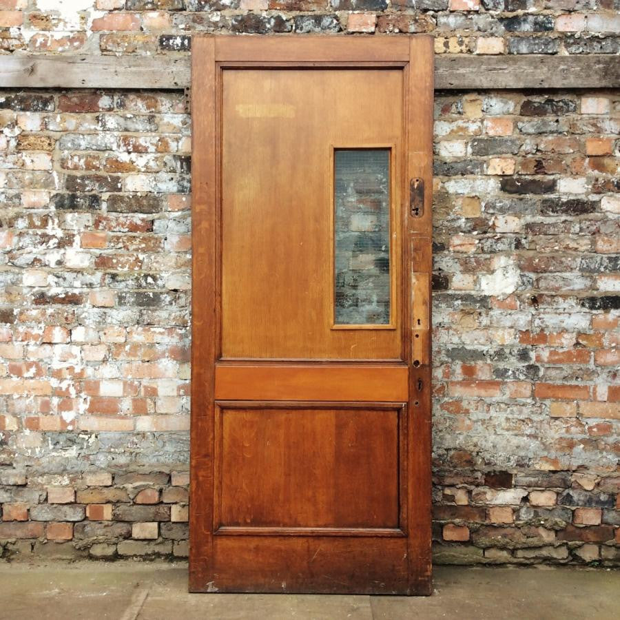 Oak door with Georgian wire glazed panels
