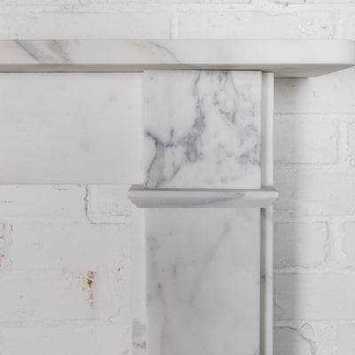 Simplistic Arabesque Marble Fireplace Surround