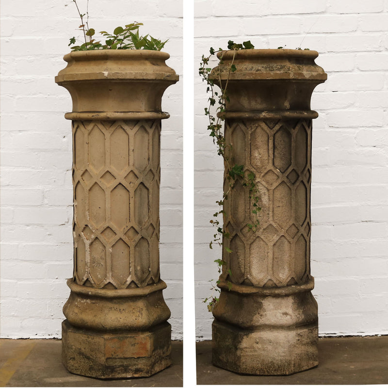 pair of stone terracotta patterned chimney stacks