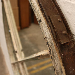 A reclaimed mirror made from an antique timber sash window frame