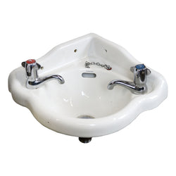 A vintage corner Pyramid double walled sink complete with Armitage Shanks taps and plug chain