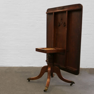 A Regency mahogany breakfast table, with tilting mechanism.