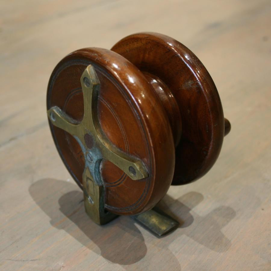 Vintage mahogany fishing reel - architectural-forum