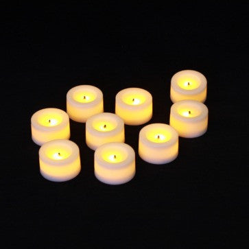 9 pack wax covered mini votive battery candles turned on