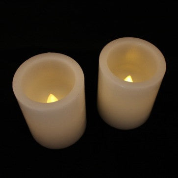 "2.5"" real wax battery candle round top (2 pack) illuminated top view"