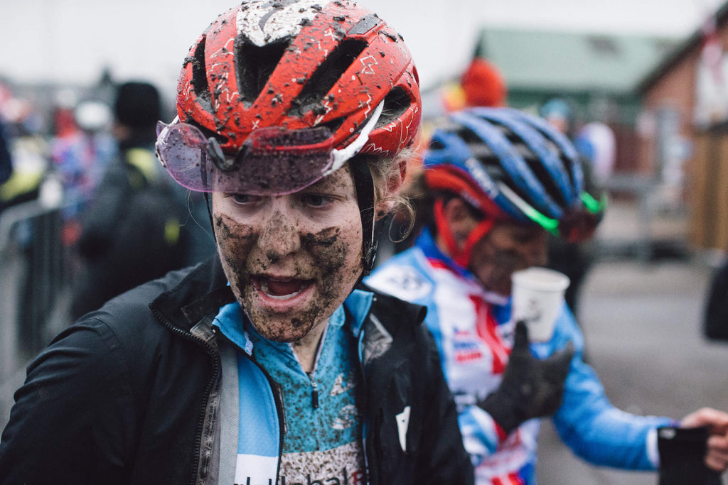 Closeup of Maghalie Rochette with face covered in mud