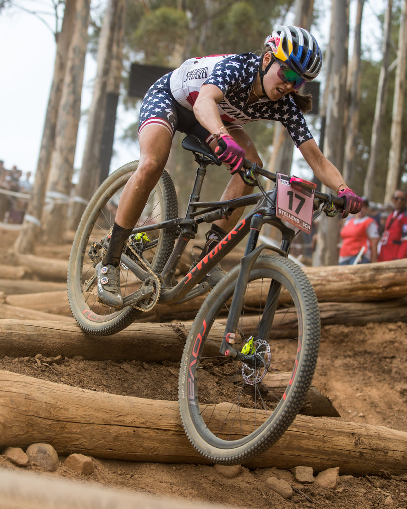 Closeup of USA female rider riding down hill