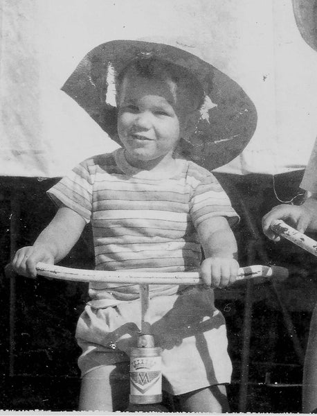 Old photo of Chuck Teixeira as toddler on bike