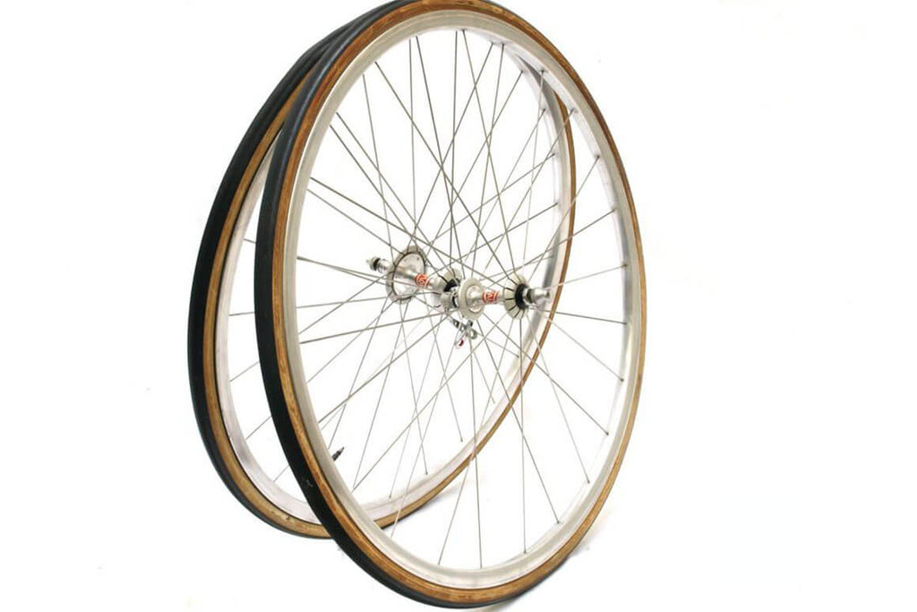 Two thin 1980s bike wheels