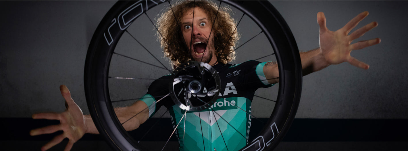 Daniel Oss excitedly tossing Roval wheel in air