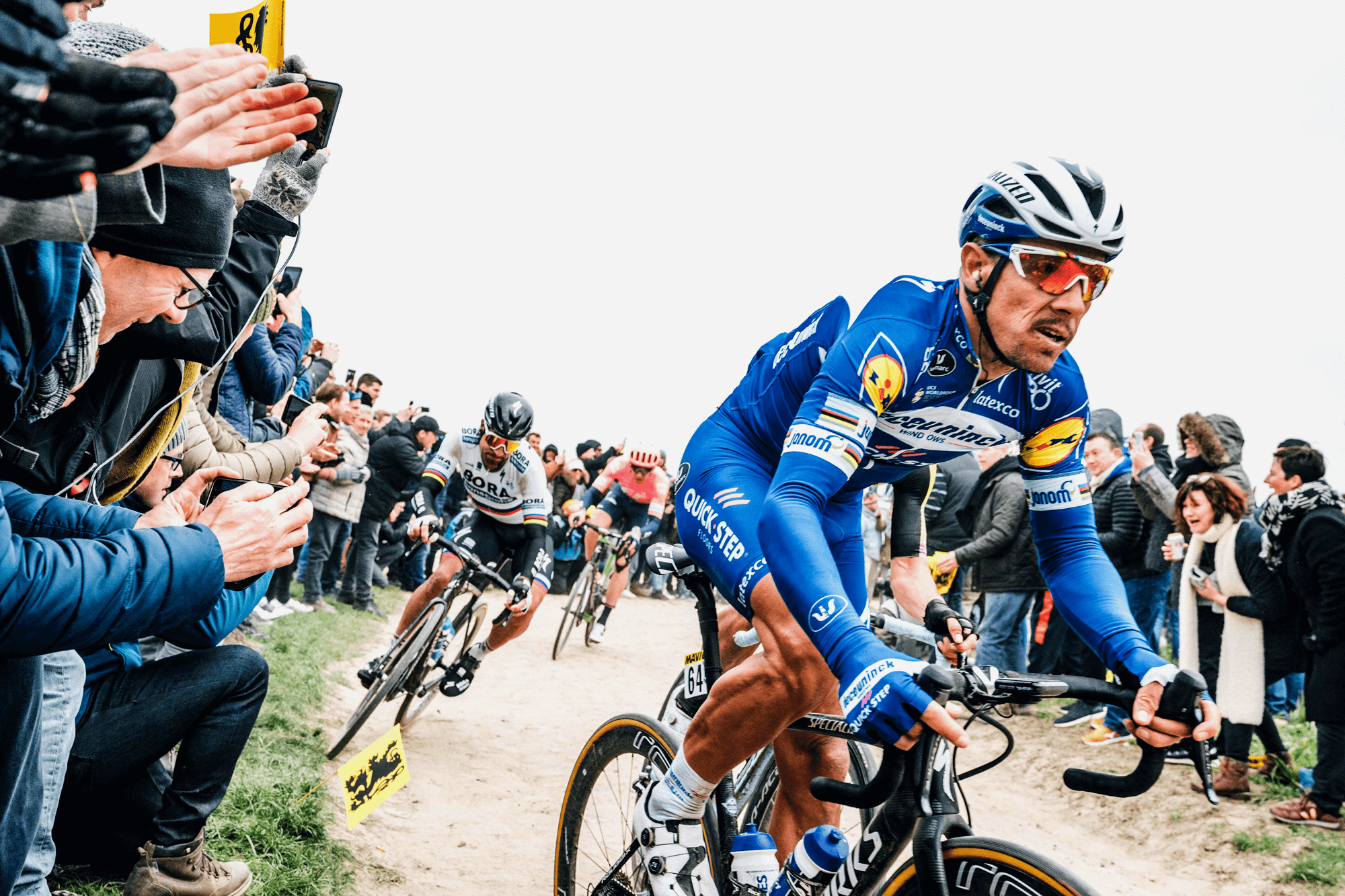 2019 Paris-Roubaix winner, Philippe Gilbert leading in front of 2018 winner Peter Sagan