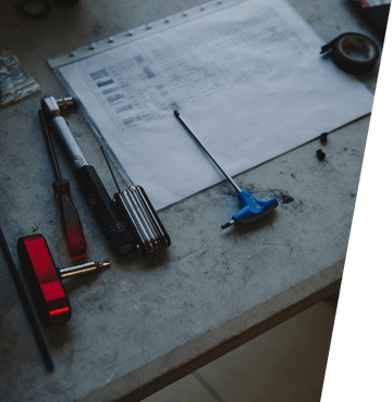 Paper schedule and bike tools lying on table