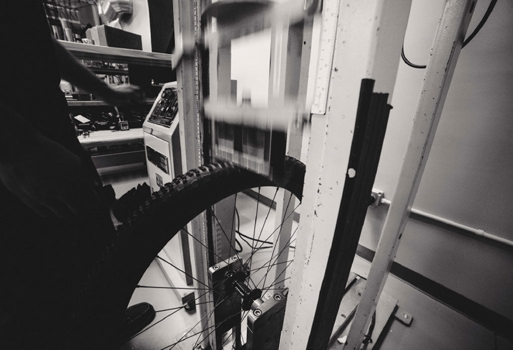 Black and white image of tire being tested in lab