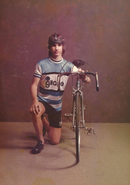 Old photo of Chuck Teixeira as young adult leaning on bike