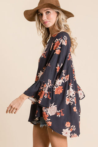 navy floral blouse with ruffle sleeves in our texas boutique aunt lillie bells