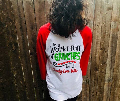 In a World of Grinches T-Shirt - Aunt Lillie Bells