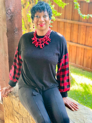 charcoal black top with red and black buffalo plaid sleeves