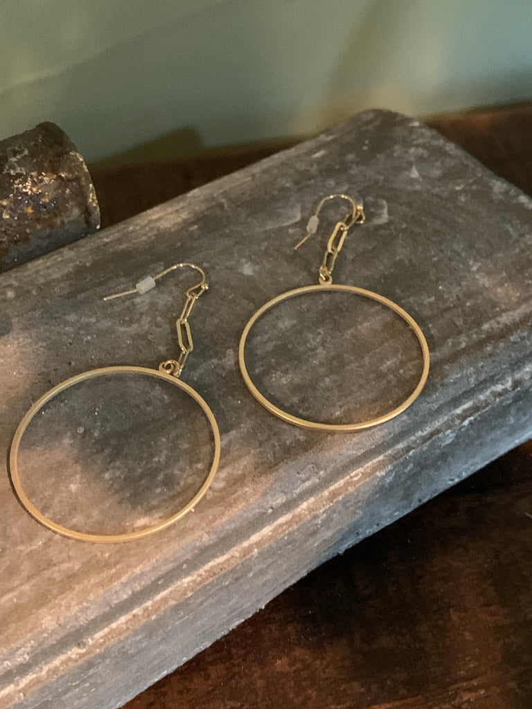 gold chain and circle earrings