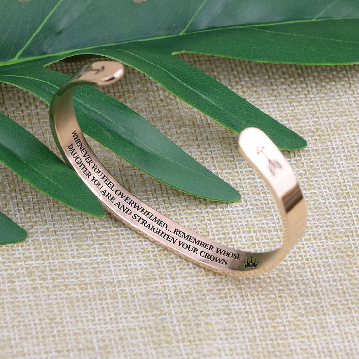 Straighten your crown bracelet with rose gold plating standing on a burlap surface with a leafy background