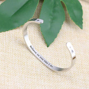 Believe in you like I do bracelet with silver plating standing on a burlap surface with a leafy background