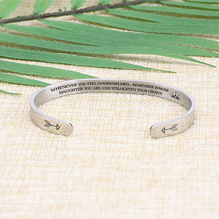 Straighten your crown bracelet with silver plating laying flat on a burlap surface with a leafy background.