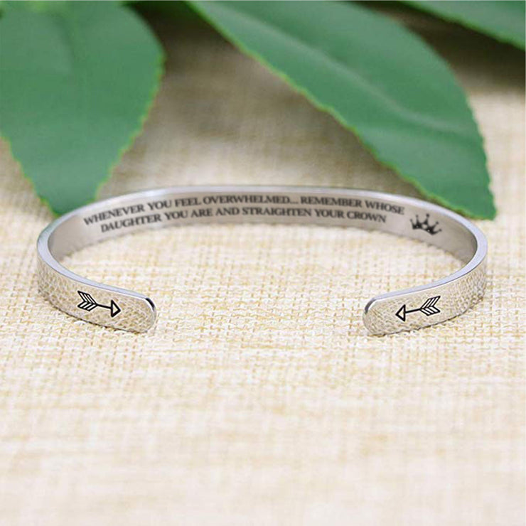 Straighten your crown bracelet with silver plating with arrows in focus on a burlap surface with a leafy background