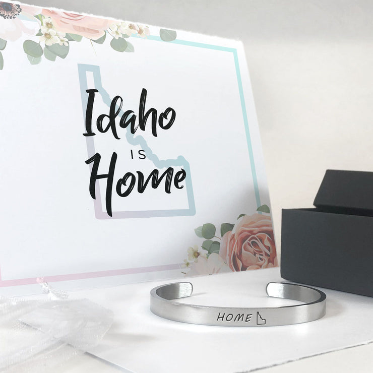 Idaho home state bracelet in silver with a gift box, bag, and card in the background