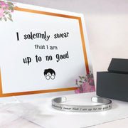 I solemnly swear that I am up to no good bracelet in silver with a gift box, bag, and card in the background