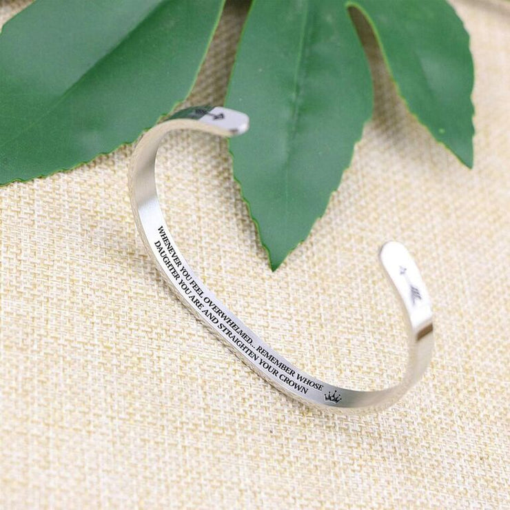 Straighten your crown bracelet with silver plating standing on a burlap surface with a leafy background.