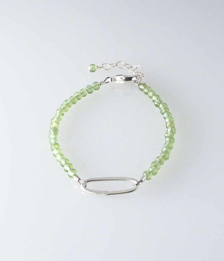 Peridot, sterling silver.    Bracelet (adjustable), 6.75-7.75""