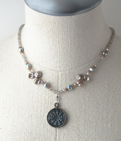 "Carved meteorite, labradoirite, keishi pearl, Czech glass, Austrian crystal, sterling silver.   Necklace (adjustable), 17-19"" with 1.5"" drop"