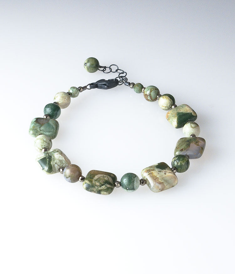 Rhyolite, oxidized sterling silver. 