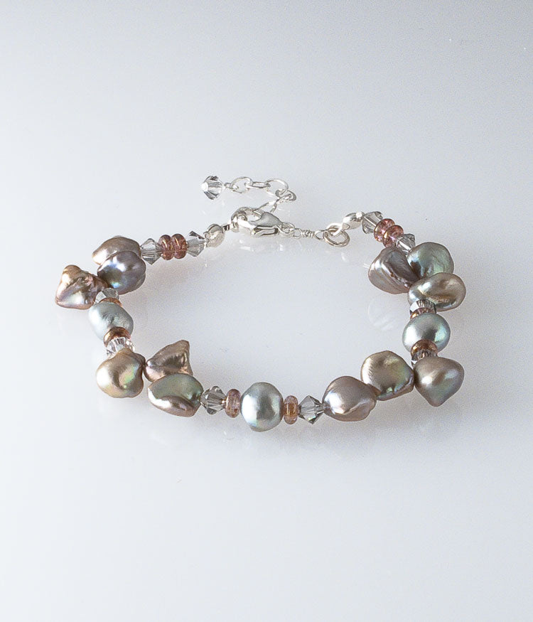 Keishi and freshwater pearl, Austrian crystal, Czech glass, sterling silver.   Bracelet (adjustable) approximately 7-8""