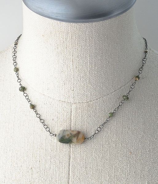 Petrified wood, rhyolite, oxidized sterling silver.   