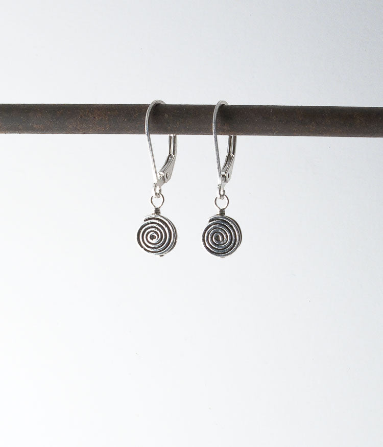 Turkish sterling, sterling silver.   I love the swirl on these! I call them the simple labyrinth earrings.   Earrings, 1""