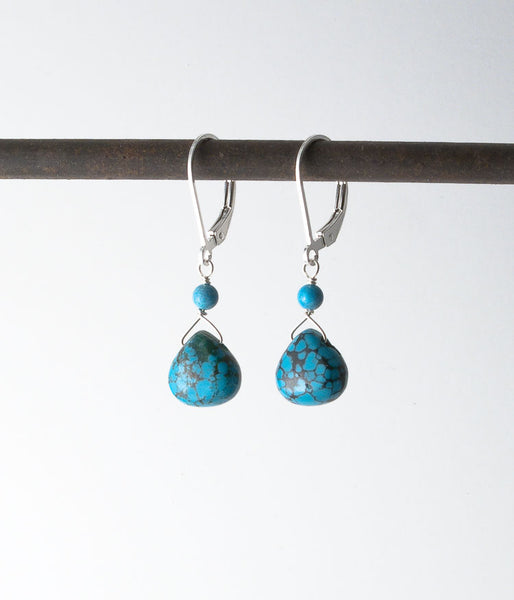 Turquoise, sterling silver.   Each pair of earrings will be slightly different in color and size due to the natural stones.   Earrings, 1.25""