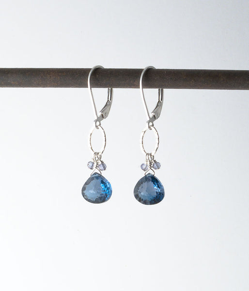 London blue topaz, quartz, sterling silver.   The cut of these stones highlights their inner brilliance. So sparkly!!!  Earrings, 1.55""