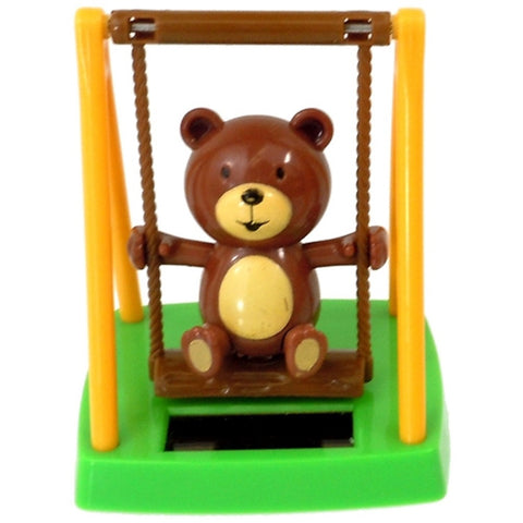 Solar Powered Swinging Bear - Swings on Playground in Sunlight