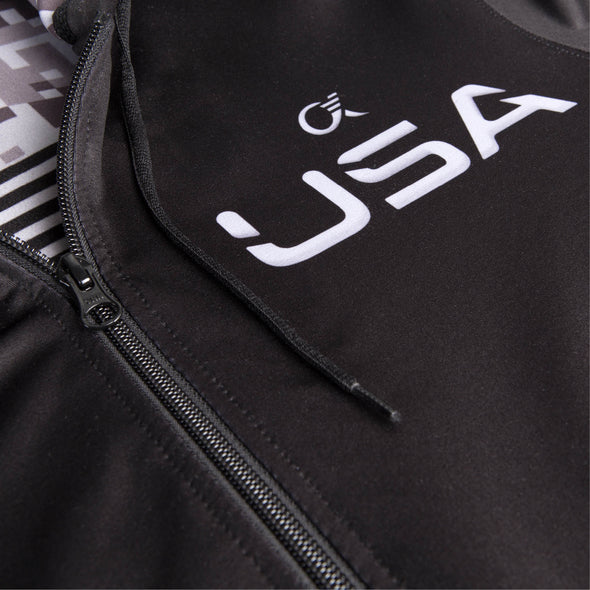 Close up detail of black dye sublimated printed hoodie, zipper, USA, black drawcord.