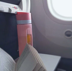 Drinking water while travelling by plane will help with dehydration, swollen ankles and a more comfortable trip.