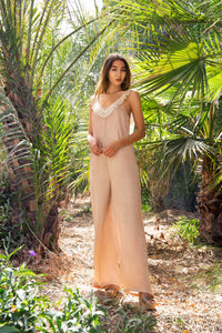 Shimmery silky jumpsuit with sequin embellished and open back. Effortlessly chic look. Easy to wear from day to night. Luxury Resort wear. Worldwide Shipping.