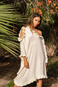 Arez Dress. Shimmery silky asymmetrical off-shoulder dress with sequin frilled edges. Easy to wear summer piece that looks elegant and chic. Luxury Resort wear. Worldwide Shipping.