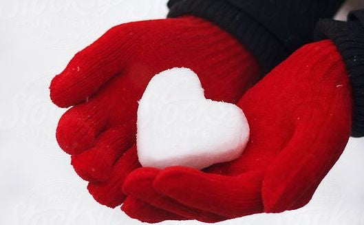 hands with snow heart