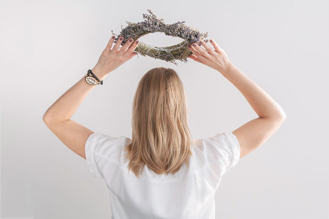 Image of woman holding a lavender crown above her head