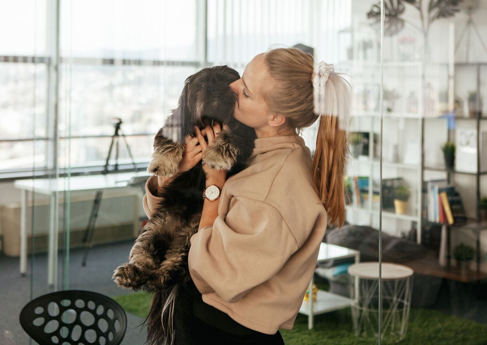 Picture of woman wearing Time and holding a puppy