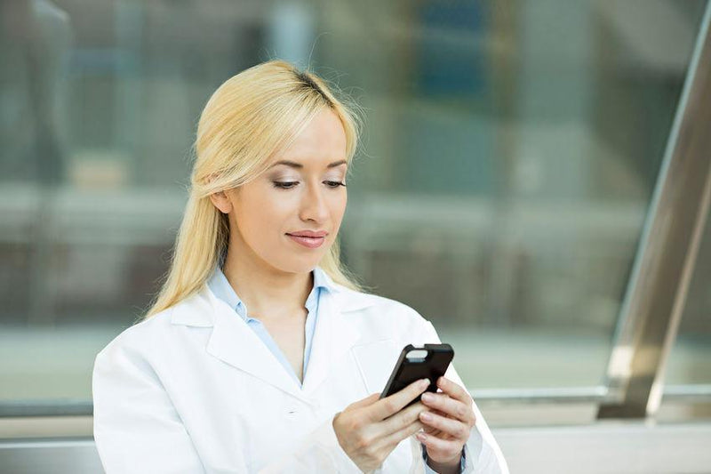 Why do many scientists around the world believe mobile phone use increases cancer risk?