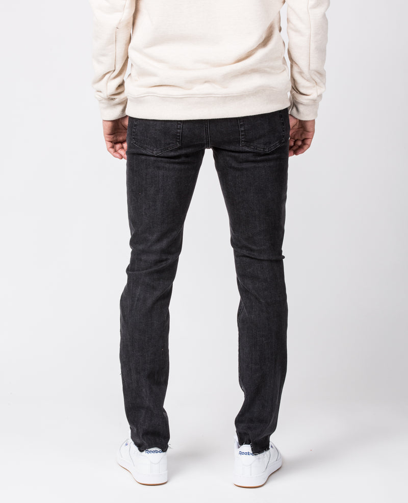 The Leo Slim-Fit jeans with ripped knees and Raw Hem